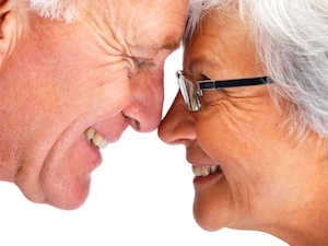Closeup profile image of an elderly couple face to face