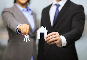 business, eco, real estate and office concept - businessman and businesswoman holding white paper ho