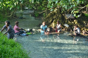 Family washing clothes in the river, Tanoliu