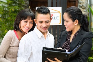 Real estate market - young Indonesian couple looking for real estate apartment or house to rent or b